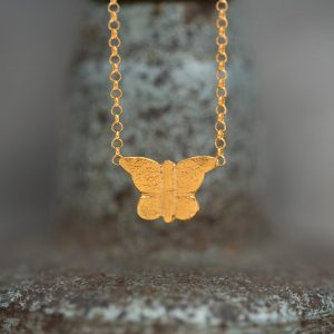 tiny butterfly pendant